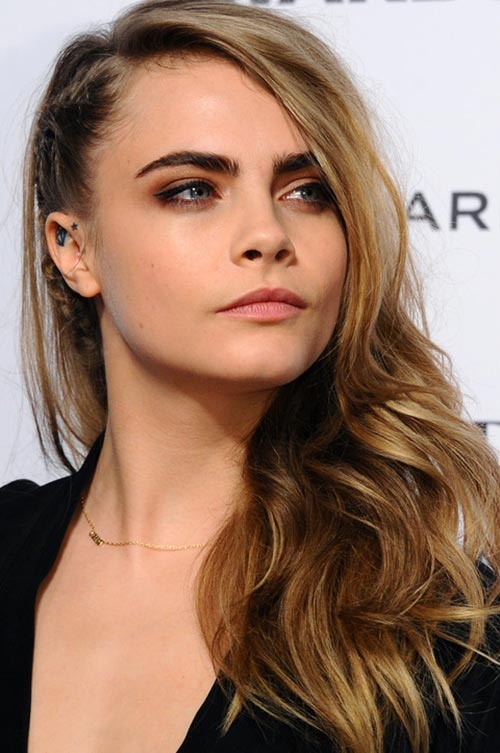 10 Trendy Braided Holiday Hairstyles: Cara Delevingne Side-Swept Hair With Cornrow Braids