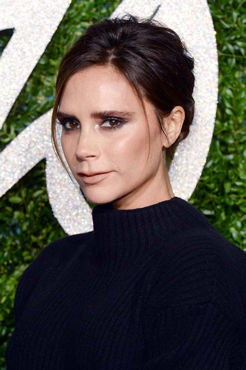 Pretty Holiday Hairstyles to Meet 2015 In Style: Loose Bun - Victoria Beckham