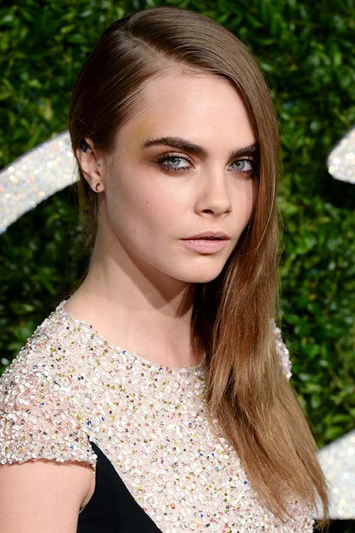 Pretty Holiday Hairstyles to Meet 2015 In Style: Side-Swept Hair - Cara Delevingne