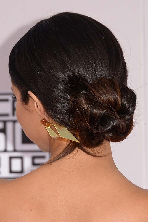 Pretty Holiday Hairstyles to Meet 2015 In Style: Twisted Bun - Selena Gomez
