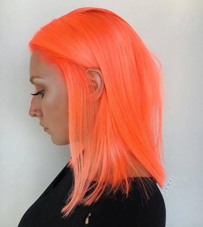 Neon Peach Hair Is The New Instagram Trend Mid Length Straight Neon Peach Hair