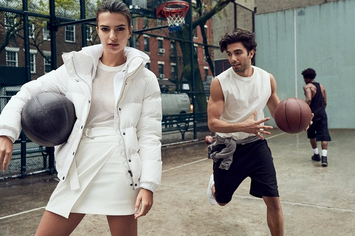 Emily Ratajkowski Masters the Street Style in DKNY's Fall 2017 Campaign cropped sweatshirt white skirt and puffer jacket