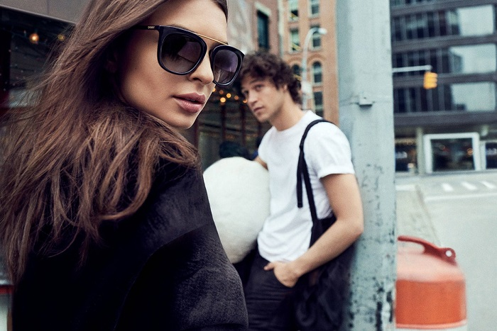 Emily Ratajkowski Masters the Street Style in DKNY's Fall 2017 Campaign red sweatshirt black sunglasses
