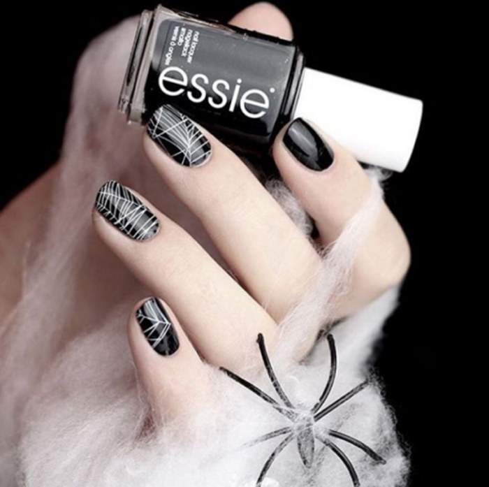Halloween Nail Ideas black nails with spider net