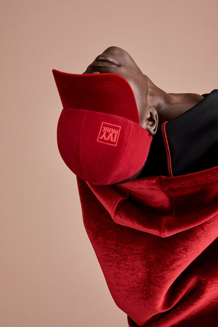 Ivy Park's Fall 2017 Collection Celebrates Diverse Beauty red hat red hoodie