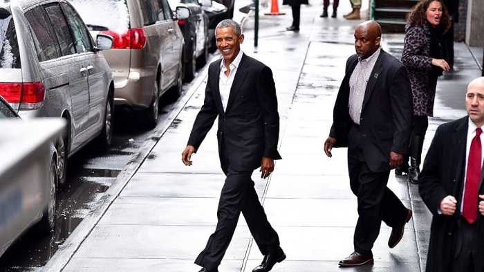 Obama's Best Style Moments Since He Left Office black suit white shirt
