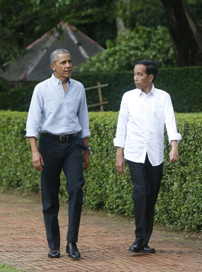 Obama's Best Style Moments Since He Left Office black pants blue shirt
