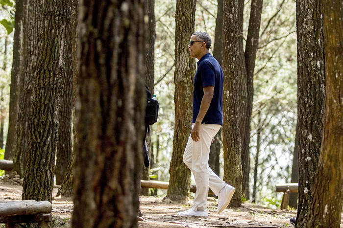 Obama's Best Style Moments Since He Left Office cream pants navy shirt