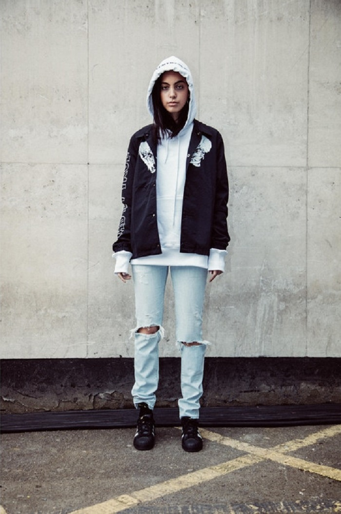 Selfridges And Metallica Unveil A Capsule Designed By Justin O'Shea ripped jeans white hoodie black jacket