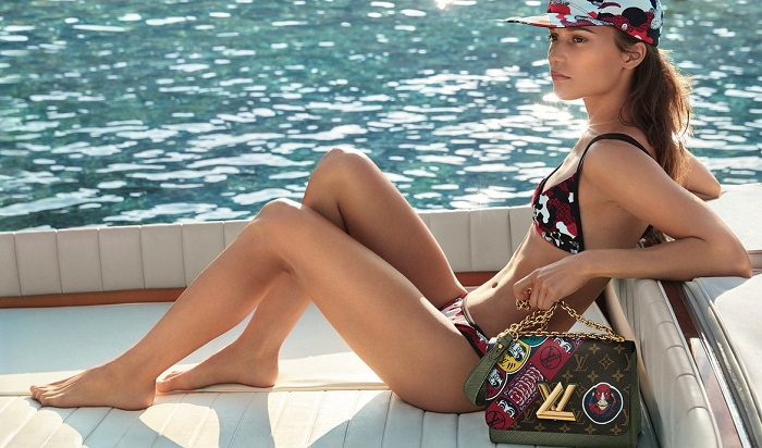 Alicia Vikander Stars In Louis Vuitton's Cruise 2018 Campaign swimsuit bag baseball hat