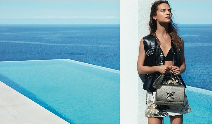 Alicia Vikander Stars In Louis Vuitton's Cruise 2018 Campaign skirt crop top leather vest bag