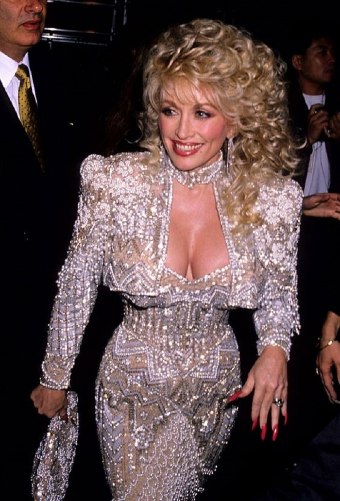 Dolly Parton's Biggest Hair Moments embellished dress curly hair