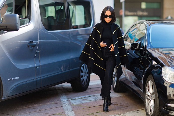 All-Black Looks That Are Anything But Boring black pants sweater black poncho jacket