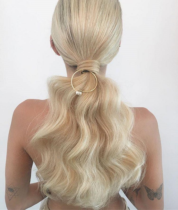 Gorgeous Hair Accessories To Glam Up Your NYE Hairstyle chic updo gold ring accessory
