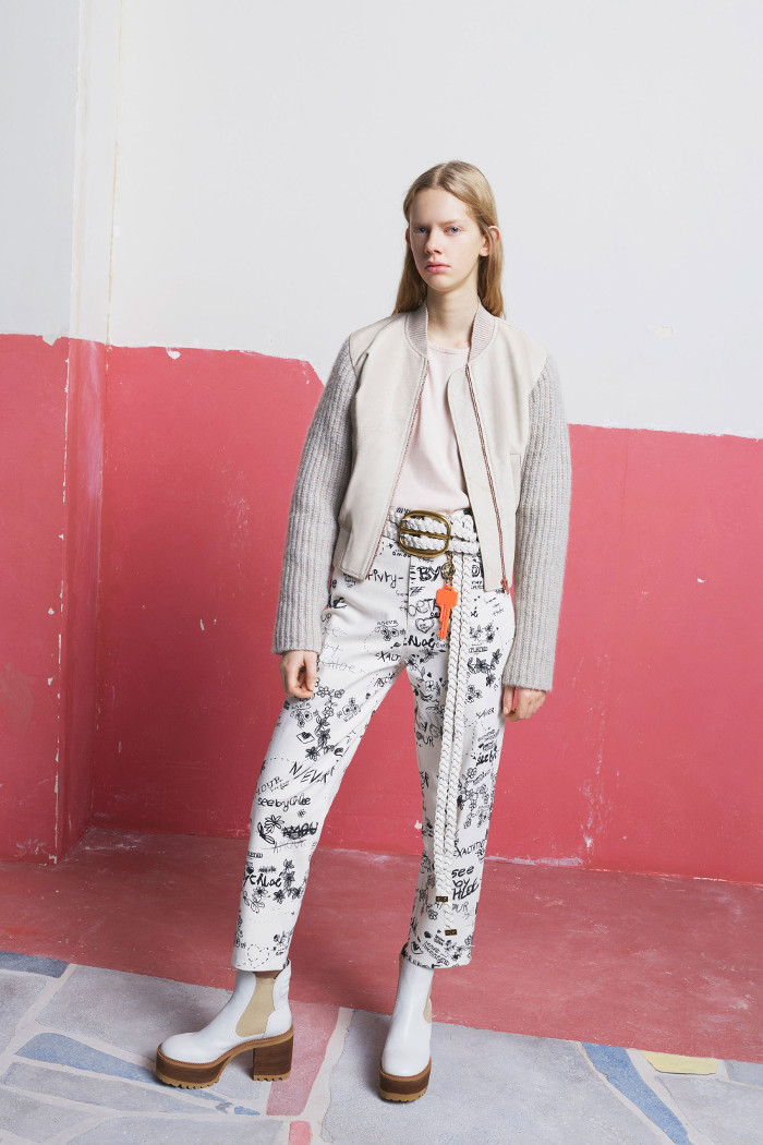 See by Chloé Pre Fall 2018 Collection floral trousers, white blouse and bomber jacket