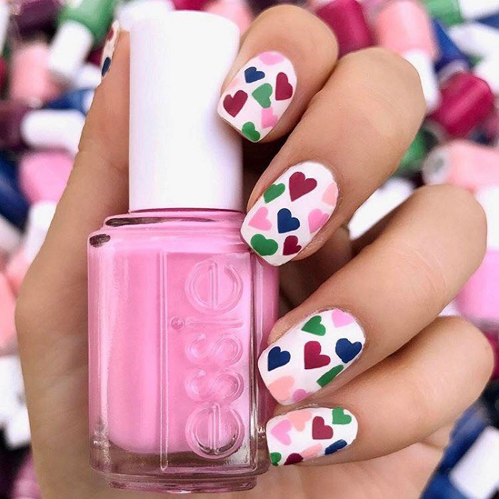 Cute Valentine's Day Nail Art To Swoon Over white nails pink blue green hearts