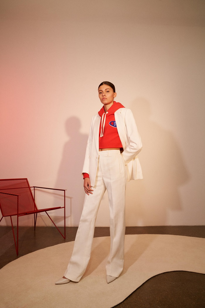 KITH Debuts Net-a-Porter Partnership with A Champion Collab white pants white jacket red hoodie