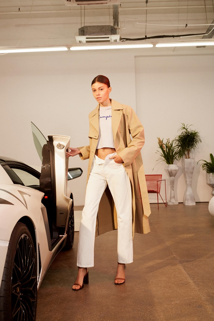 KITH Debuts Net-a-Porter Partnership with A Champion Collab white pants white t shirt cream trench coat