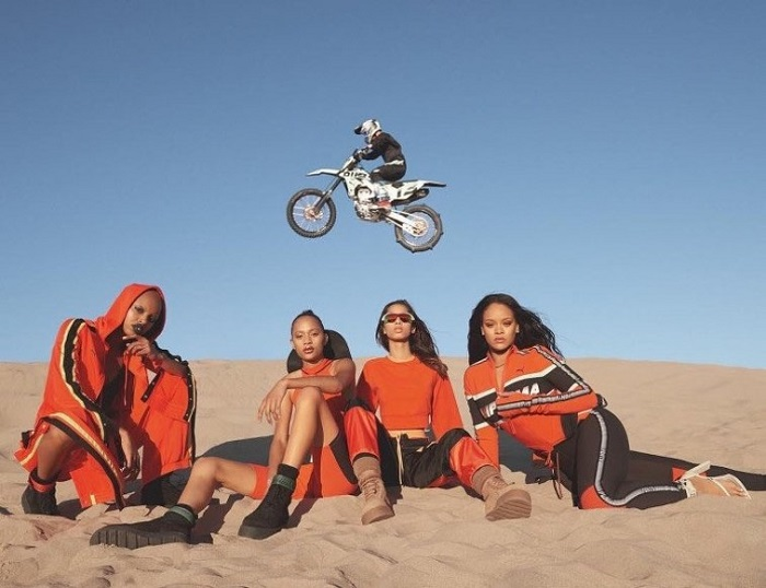 Rihanna's Fenty x Puma Spring 2018 Campaign Is Here orange and black bodysuit track pants
