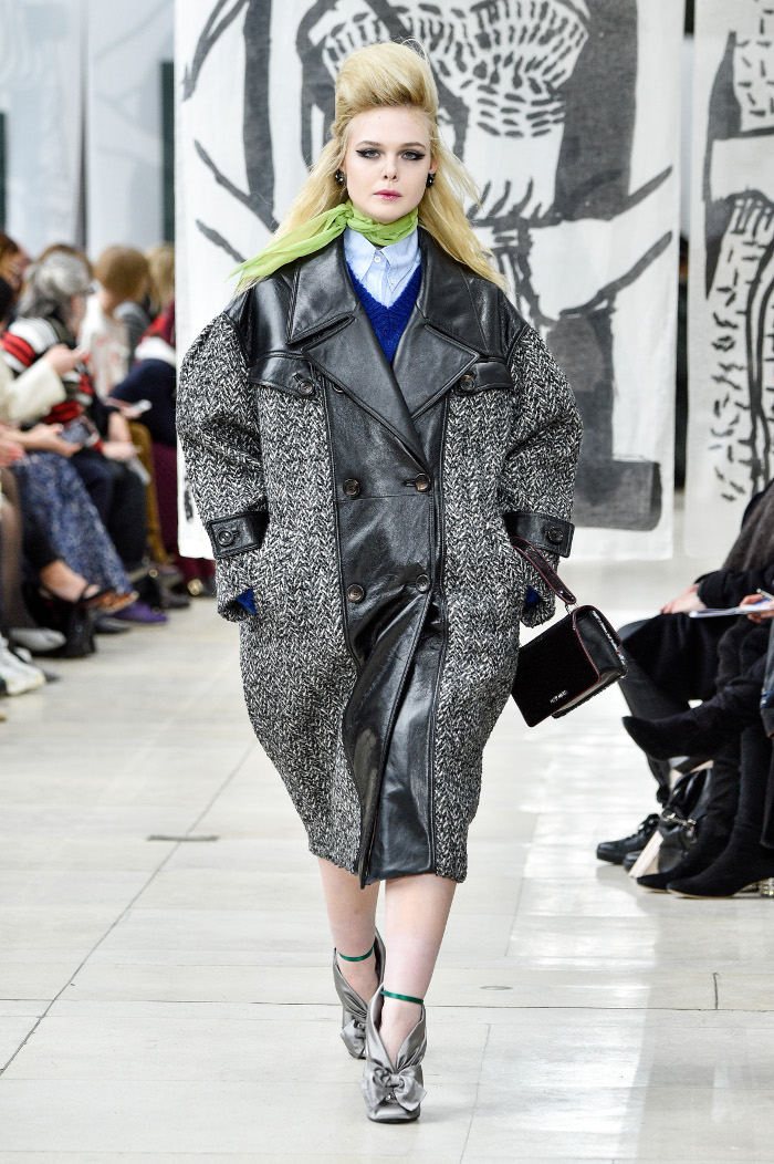 Elle Fanning Made Her Runway Debut at PFW Elle Fanning in an oversized leather and tweed coat