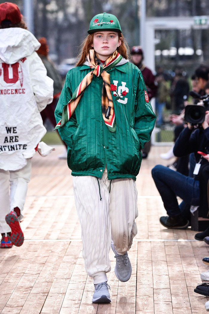 Stranger Things Sadie Sink Made Her Runway Debut at PFW green jacket and white joggers