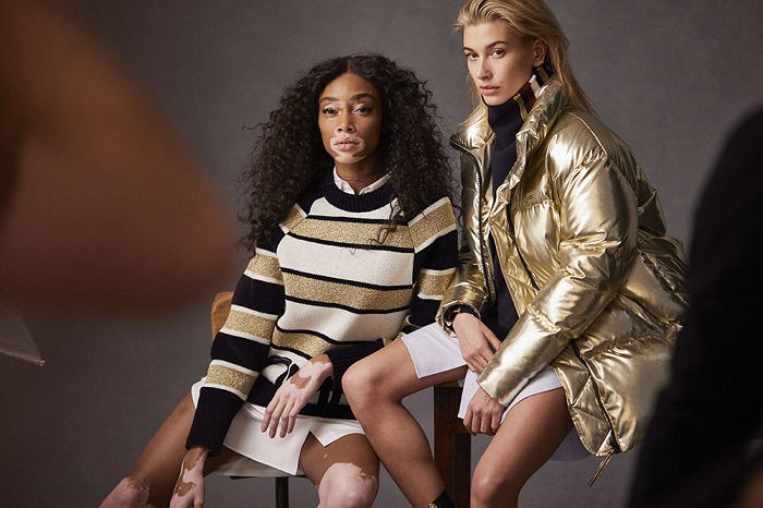 Hailey Baldwin & Winnie Harlow Are Tommy Hilfiger's New Ambassadors gold puffer white skirt striped sweater