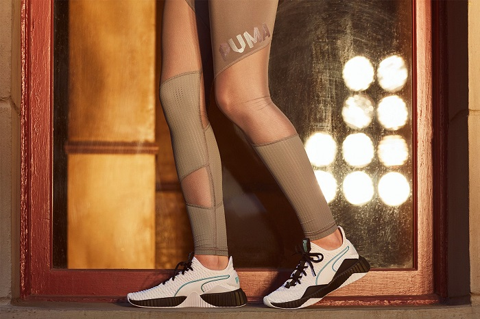 Selena Gomez Presents Puma's New Defy Sneaker tan leggings white sneakers