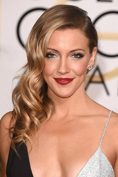 2015 Stylish Celebrity Hairstyles: Katie Cassidy Side-Swept Curls