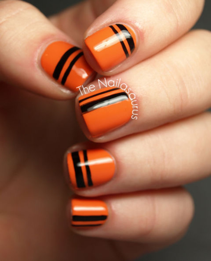 Halloween Nail Ideas burned orange nails with black stripes