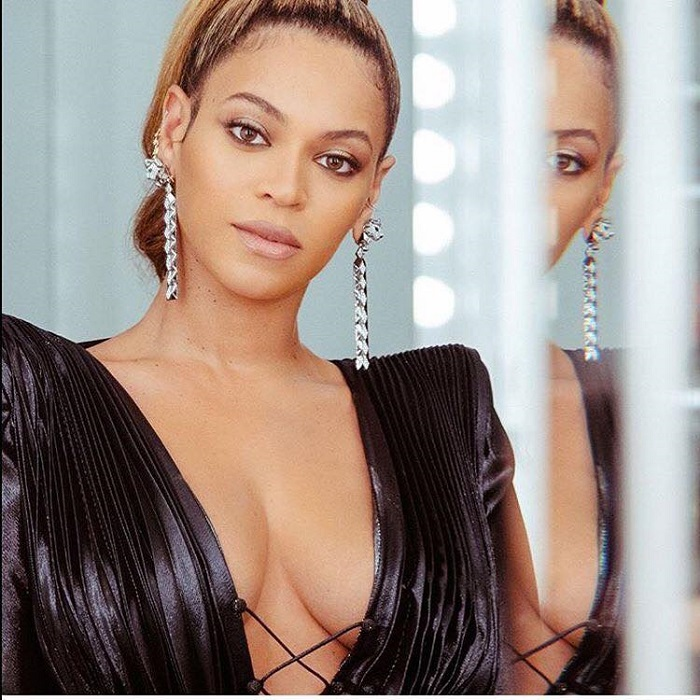 Beyoncé And Glossier Tease New Product At The Grammys black dress nude lip sparkling eyeshadow