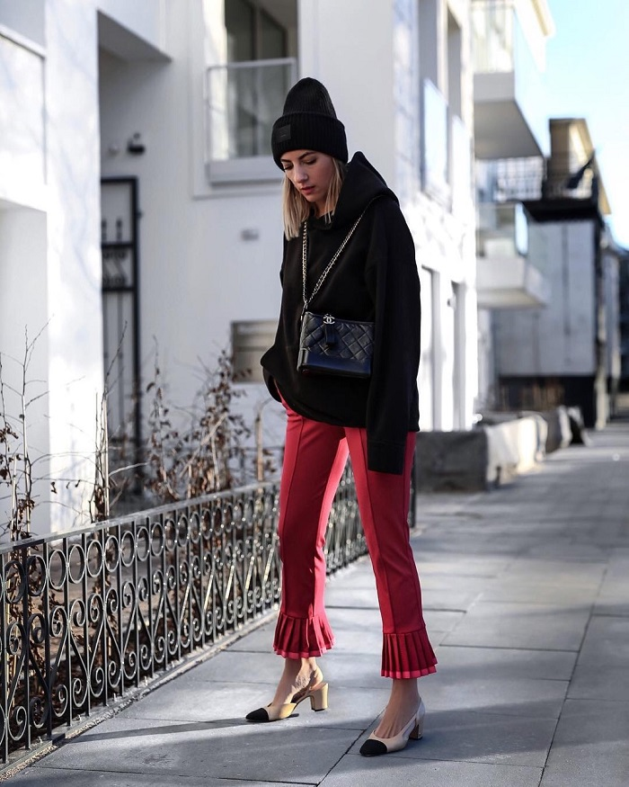 Fresh Ways To Rock A Hoodie This Season red pants black hoodie
