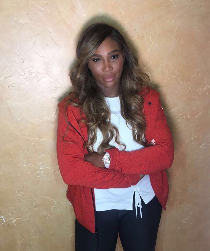 Serena Williams to Launch Beauty Brand Aneres curly hair red jacket white top