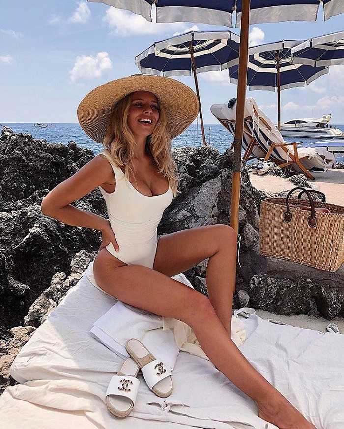 16 Ways To Style A Straw Hat For Hot Days white swimsuit