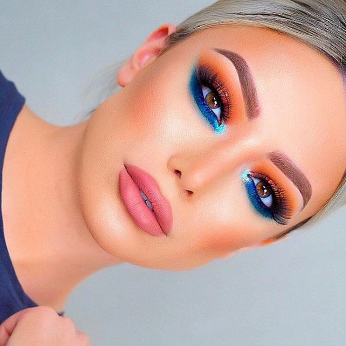 Colorful Makeup Looks to Don at A Summer Party orange eyeshadow blue underliner