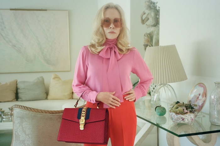 Faye Dunaway Fronts Gucci's Sylvie Bag Ads At 77 red pants pink top red bag
