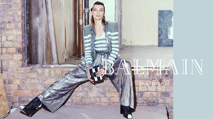 Milla-Jovovich-Fronts-Balmain's-Fifth-Element-Inspired-Fall-2018-Ads-stripe sweater metallic pants